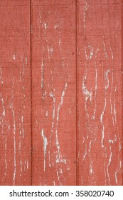 Peeling red paint on wooden siding for background