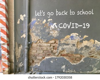 Peeling wall with back to school writing