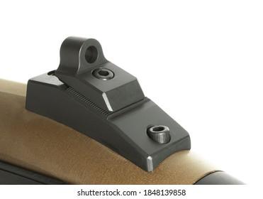 Peep sight mounted on back of a shotgun isolated on white