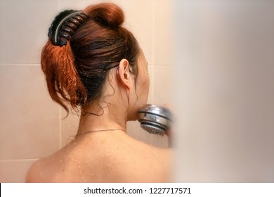 Peeping Tom View of a Woman in The Shower
