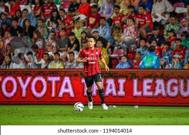 Peerapat Notchaiya (red) of Muangthong United in action during Football Thai League 2018 match between SCG Muangthong United and Burirum United at SCG Stadium 16August 2018 Nonthaburi ,Thailand.