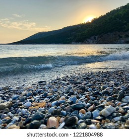 Pefkos Beach / Skyros Island / Greece / August 2018: Sunset in one of the best beaches at Skyros Island in Greece