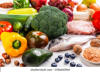 Pegan diet products on white stone background. Healthy eating concept paleo plus vegan approach. Copy space