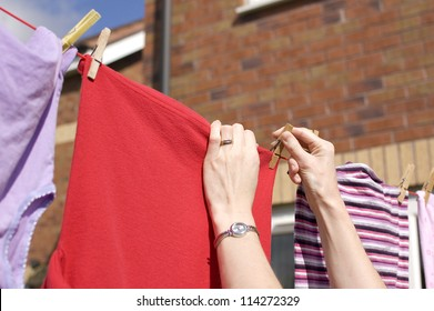 Pegging out washing to dry on clothes line