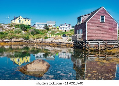 Peggy's cove landscape of water reflection and houses in Nova Scotia, Canada.