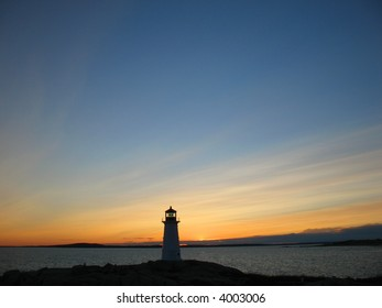 Peggys Cove lighthouse with big sky at dusk