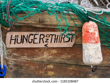 PEGGY'S COVE, NOVA SCOTIA, CANADA - JULY 17, 2018: Hunger and Thirst boat in fishing harbor.