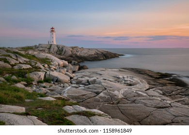 PEGGY'S COVE, NOVA SCOTIA/CANADA - July 16, 2018:  Panorama of Peggy's Point, or Peggy's Cove, Lighthouse at dusk on Peggy's Cove