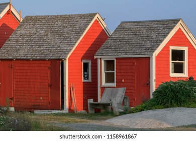 PEGGY'S COVE, NOVA SCOTIA/CANADA - July 16, 2018:  Wooden chair in back of red cottages at Peggy's Cove, Nova Scotia