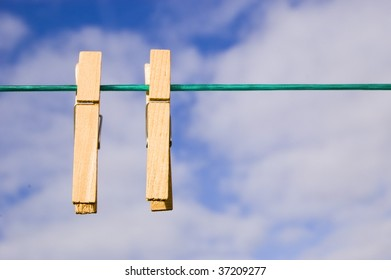 Pegs hang on a washing line on a sunny day