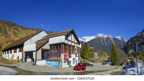 PEIO FONTI, ITALY - MARCH 20, 2019: Lower cable car station in Peio Fonti 1400. Spring skiing in the Peio ski area. Trento Autonomous Province, Trentino Region, Upper Adige