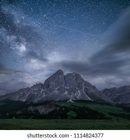 Peitlerkofel mountain in south tyrol, dolomites, with beautiful sky with stars, Amazing view of mountain with greenery and sky with stars and clouds at night