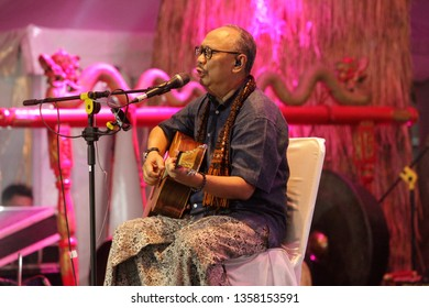 Pekalongan / Indonesia - April 02, 2019: Ebiet G Ade is a legendary Indonesian musician, a public performance in the 113th anniversary of Pekalongan city. taken at night with ISO 4000
