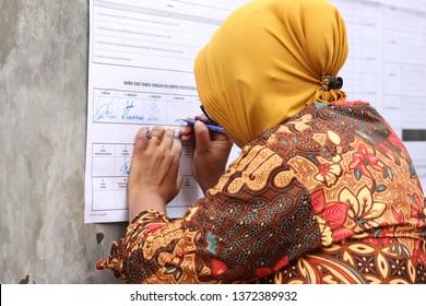 Pekalongan/Indonesia - April 17, 2019 : vote counting process at TPS. Indonesian elections 2019 in Pekalongan City. proses perhitungan suara di TPS. Pemilu Indonesia 2019 di Kota Pekalongan