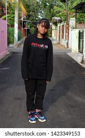 Pekalongan/Indonesia - June 07,2019 : the style of a girl with a writing shirt: Indonesian shutterstock. in Pekalongan City