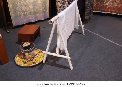 Pekalongan/Indonesia : October 05, 2019 : the traditional batik process using a canting on a white cotton cloth