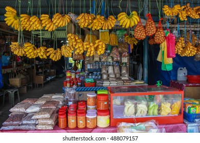 Pekan Nabalu, Sabah Malaysia- SEPT 11, 2016:  Stall selling fruits, deliciously nutty flavored brown hill rice, and traditional food in Pekan Nabalu, Sabah Malaysia
