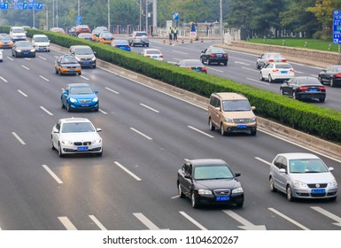 PEKING CHINA-May 20, 2018: light fog and haze, high-speed vehicles running on the Guanganmen Expressway in Beijing. At present, China's vehicle ownership exceeds 300 million vehicles.