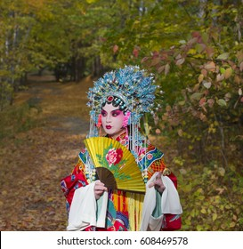 Peking opera performer in the fall outdoor park, Toronto, Canada