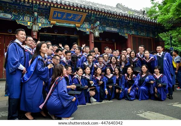 Peking University,Beijing,China-July 2,2016:Graduates  take Graduation photos at the Beijing university West gate.