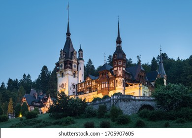 Peles Castle, famous residence of King Charles I in Sinaia, Romania. Summer landscape at dawn of royal palace and park.
