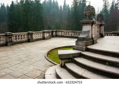 Peles castle ornamental garden balcony, Sinaia, Romania. Landmark of Carpathian mountains in Europe. View from the left.
