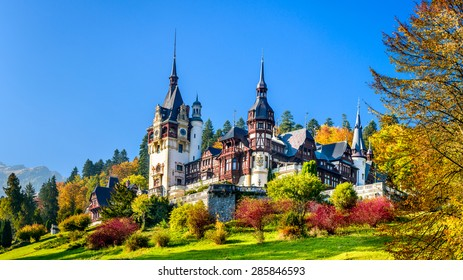 Peles Castle, Romania. Beautiful famous royal castle and ornamental garden in Sinaia landmark of Carpathian Mountains in Europe