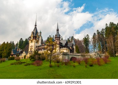 Peles castle, Sinaia, Romania. Blue sky and white clouds.