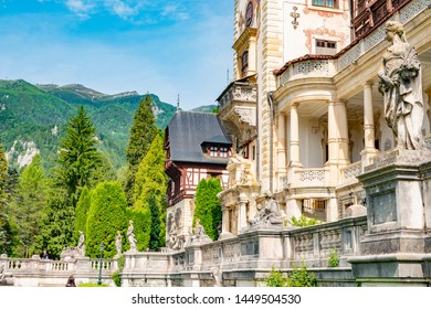 Peles castle. Sinaia, Romania June, 9th, 2019. View from the front Garden  of Peles castle in Sinaia Romania. the garden is full of well preserved statues.
