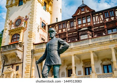 Peles castle. Sinaia, Romania June, 9th, 2019. Statues of King Carol in front of Peles castle in Sinaia, Romania