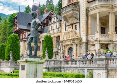 Peles castle. Sinaia, Romania June, 18th, 2019. Statues of King Carol in front of Peles castle in Sinaia, Romania