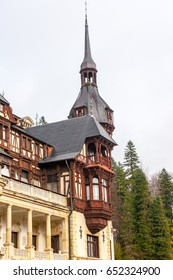 Peles castle, Sinaia, Romania on a beautiful autumn day. Royal balcony lower left.
