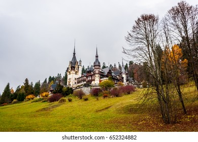 Peles castle, Sinaia, Romania.Overcast on a beautiful autumn day.Wider view.