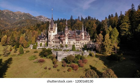 Peles, Sinaia, Romania, October 02 2018: Aerial view of Peles Castle in Sinaia, Carpathian mountains, Brasov region, Romania. Beautiful autumn landscape in castle surrounded with the forest and high m