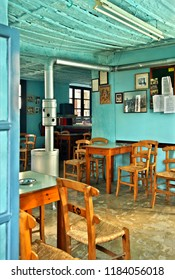 """PELION MOUNTAIN, THESSALY, GREECE - November 27, 2012. The """"Forlida"""" coffee shop (""""kafeneio""""), the oldest one in Greece (since 1785), in  Lafkos village, South Pelion, Magnesia (Magnisia) Thessally."""