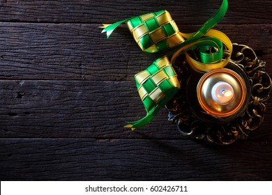 pelita or oil lamp on the wooden background