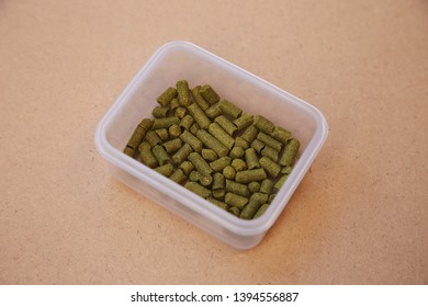 Pellet hops inside a plastic container. Homebrewing concept image.