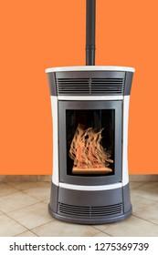 pellets stove on orange background