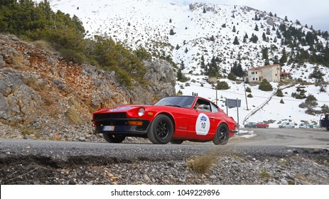 PELOPONNESE, GREECE, MARCH 3rd 2018. Classic car Datsun 240Z, made in Japan in 1971, on mountainous roads with snowy background, at 9th Classic Rally of Greece, organized by FILPA and SISA.