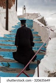 PELOPONNESE, GREECE - OCTOBER 11, 2005: An unidentified Greek-Orthodox priest leaves a monastery after celebrating Mass. Economic crisis upgraded even more the role of the Church in Greece.