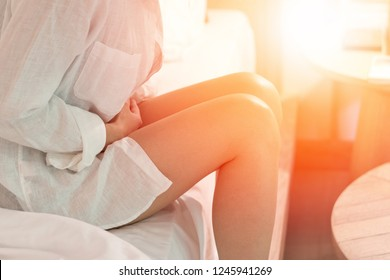 Pelvic pain stomachache medical healthcare concept. Hands of young woman on stomach as suffer from menstruation cramp, indigestion, gastrointestinal, diarrheas  or female diseases problem