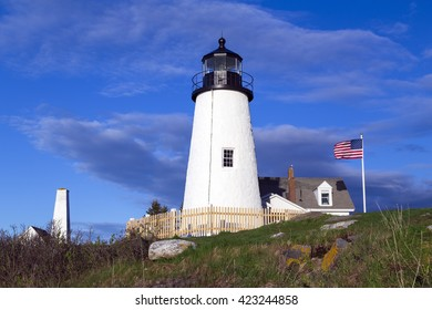 Pemaquid Point Lighthouse on a sunny day in Bristol, Maine.