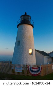 Pemaquid Point Lighthouse at sunset on a summer evening
