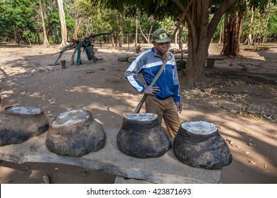 PEMBA, Mozambique - circa August 2012: a ranger is looking at the feet of elephants. These animals were killed by poachers couple of days earlier and it is sad and defeated moment for everyone
