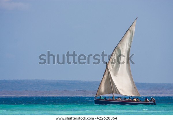 Pemba, Mozambique - circa August 2012: a traditional sail boat on turquoise water
