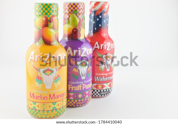 Pemberton, Manchester, UK, 27/07/2020 : three bottles of Arizona cowboy cocktails with copy space to the right, isolated on a white background in horizontal format