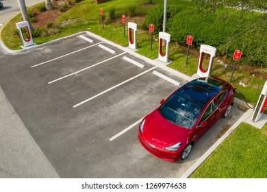 PEMBROKE PINES, FL, USA - DECEMBER 15, 2018: Aerial photo Tesla Model 3 supercharging