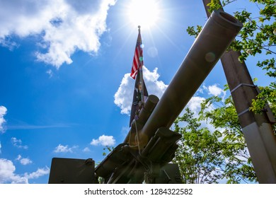 PEMBROKE PINES, FLORIDA, USA - JUNE 4, 2018: M114A2 155 mm howitzer with POW MIA and American flag at Fletcher Park veterans memorial
