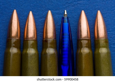 Pen among cartridges over blue background - freedom of speech concept