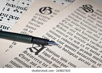 Pen and ancient gothic text. Dummy text Lorem ipsum